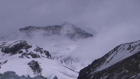 Clouds moving across the North Face of Mt. Everest from a distance Footage