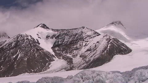 Time lapse of clouds moving across peaks and pyramids of ice near Mt. Everest Footage