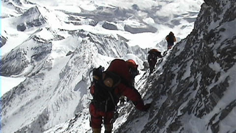 In the death zone climbing towards the summit of Everest - Climbers navigate difficult, scary terrai Footage