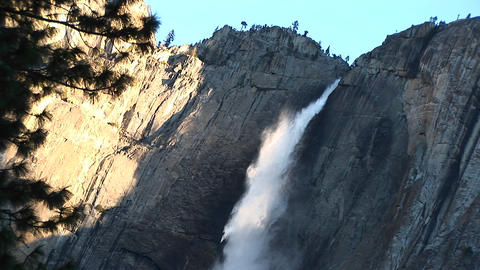 This golden-hour view of a waterfall shows the shadow of... Stock Video Footage