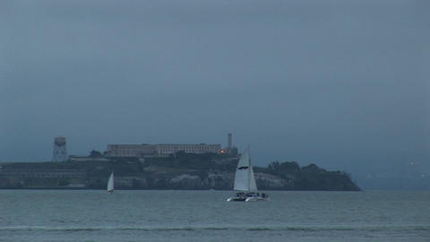 Medium shot of a catamaran moving past historic Alcatraz... Stock Video Footage
