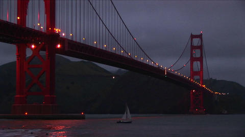 A worms-eye view of the Golden Gate Bridge at night with... Stock Video Footage
