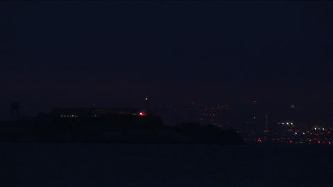 A nighttime view of San Francisco with Coat Tower's light flashing Footage
