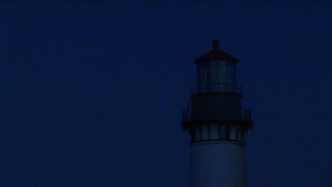 A close-up of the beacon at top of lighthouse tower at night Stock Video Footage