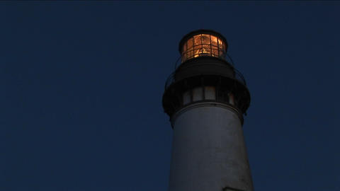 A worms-eye view of functioning lighthouse at night Stock Video Footage
