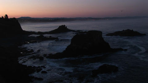 A broad band of pink and orange sky brightens this... Stock Video Footage