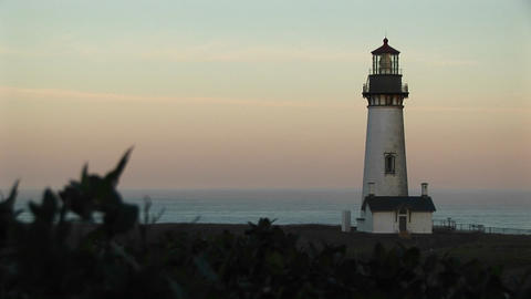Wide Shot Of A Pastel Sky And A Picture-perfect Lighthouse stock footage
