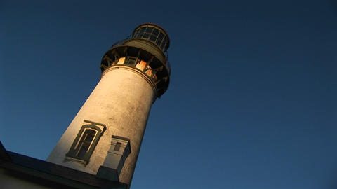 A montage of an old lighthouse at a jaunty angle in the... Stock Video Footage