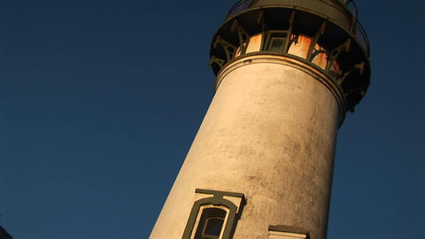 Pans up a lighthouse Stock Video Footage