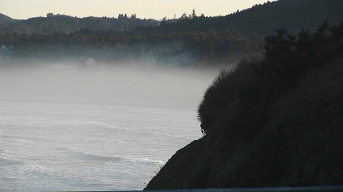 As mist rises above the ocean near the shore, nature's brilliant colors become as soft and subtle as Footage