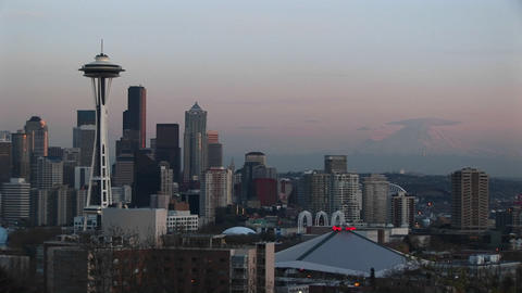 Seattle's landmark Space Needle dominates the city's skyline during the golden hour Footage