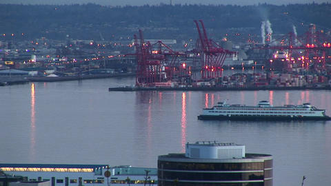 A cruise ship slowly makes its way through Seattle's busy harbor in the golden hour Footage