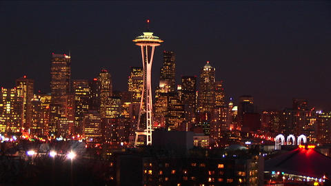 Seattle's stunning skyline at night looks golden from the many lights Live Action