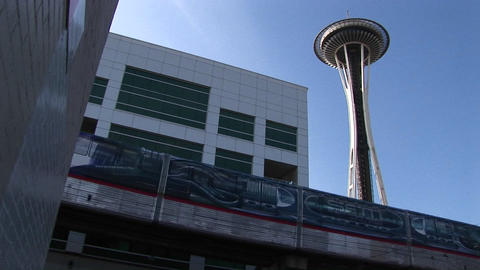 A low-angle view of the monorail passing the Space Needle and other downtown Seattle buildings Footage