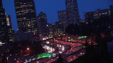 A close-up of downtown Seattle buildings with heavy traffic flowing along major expressways Footage