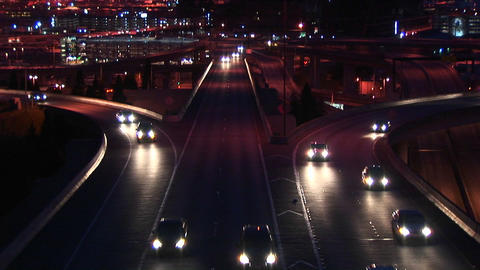 Vehicles enter a freeway in rush hour at night Footage