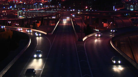 Vehicles enter a freeway in rush hour at night Stock Video Footage