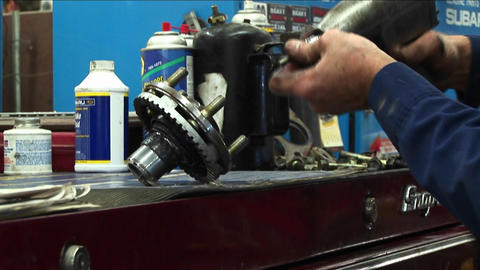 Close-up of a mechanic removing bolts from a part with a... Stock Video Footage