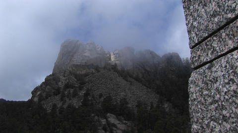 Long-shot of fog rising from the faces of the Presidents at Mt. Rushmore in South Dakota Footage