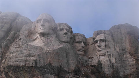 A look up at Mt. Rushmore before all the mist has dissipated Stock Video Footage