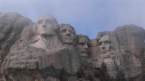 A look up at Mt. Rushmore before all the mist has dissipated Footage