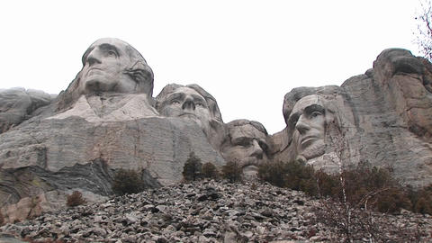 A worm's eye montage of Mt. Rushmore from unusual perspective Footage