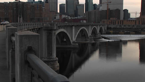 Pan-up from bridge on Mississippi River to skyline of... Stock Video Footage