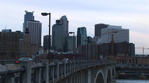 Traffic moves across a bridge into the city in this clip Stock Video Footage