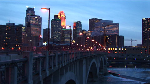 Medium-wide-shot of Minneapolis, Minnesota skyline from the Mississippi River during the golden-hour Footage