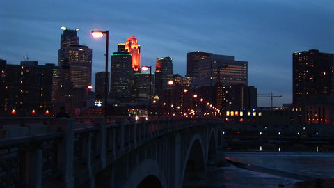 Medium wide shot of night traffic on bridge over the Mississippi River along the waterfront of Minne Footage
