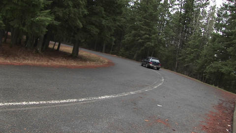 A car travels on a wooded country road Stock Video Footage