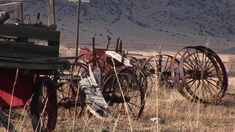 Broken and rusty, vintage wagon-wheel rims and other old... Stock Video Footage