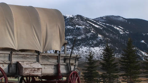 Different views of a covered wagon on the prairie Footage