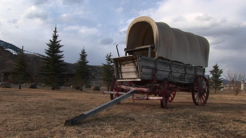 A covered wagon looks right at home against the backdrop... Stock Video Footage