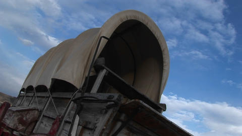 Worms-eye view of a covered wagon against a blue sky Stock Video Footage