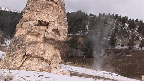 Tilt-shot of an eroded limestone cone in Yellowstone National Park Footage