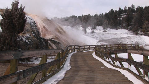 A tourists' walkway passes a number of hot springs in Yellowstone National Park Footage