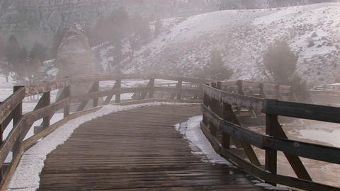 Steam rises from the hot springs area in Yellowstone National Park Footage