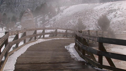 Steam rises from the hot springs area in Yellowstone... Stock Video Footage