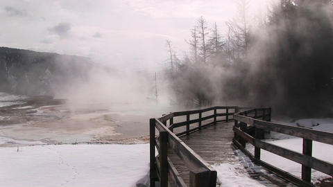 Medium-shot of steam rising from a thermal pool at... Stock Video Footage