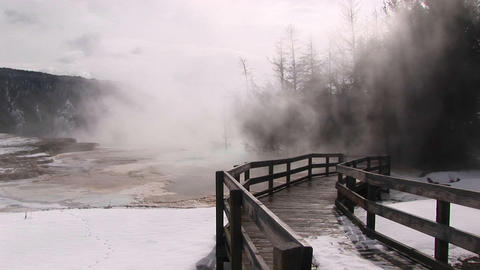 Medium-shot of steam rising from a thermal pool at Yellowstone National Park, Wyoming Footage