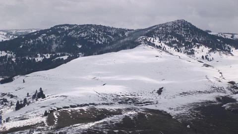 Snow covers a mountain's broad slope Stock Video Footage
