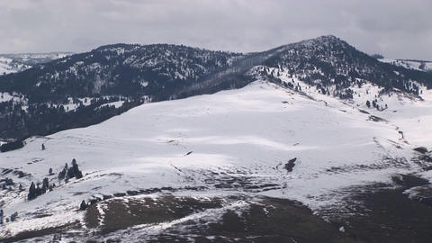 Snow covers a mountain's broad slope Footage
