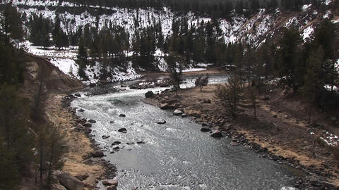 Camera looks down on a picturesque mountain stream in winter Stock Video Footage