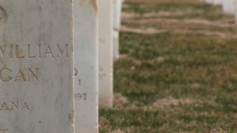 A close-up of individual headstones indicates the men and women buried beneath came from a variety o Footage