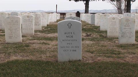 The camera pans right across rows of white headstones in... Stock Video Footage