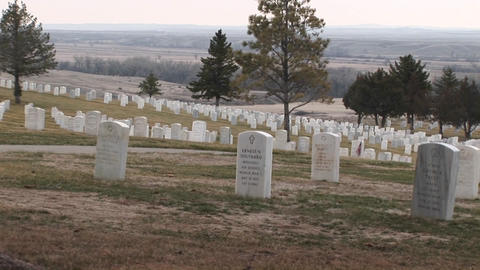 A panoramic view of Arlington National Cemetery with white marble headstones arranged in precise row Footage