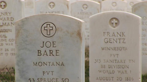 headstones for soldiers who died in World War I are shown in the foreground of this clip from Arling Footage