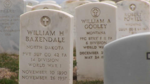 A close-up of the inscriptions on the Arlington National Cemetery gravestones of those who served in Footage