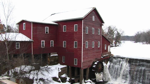 A classic old mill with waterwheel Stock Video Footage